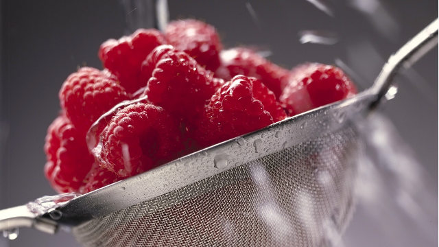 Washing fresh raspberries