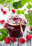 raspberry-jam-in-a-jar-and-fresh-berries-on-the-wooden-table