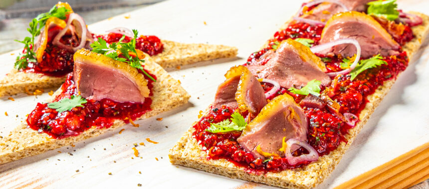 Smoked Duck on black pepper flatbread, BC Raspberry compote appetizer